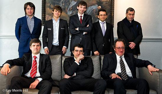 The eight candidates: Teimour Radjabov, Magnus Carlsen, Alexander Grischuk, Levon Aronian, Vassily Ivanchuk (standing); Peter Svidler, Vladimir Kramnik, Boris Gelfand