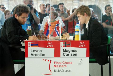 Levon Aronian pawning off against Magnus Carlsen.