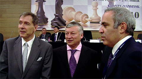 Richard Conn, a dapper Anatoly Karpov and Garry Kasparov on the floor during the FIDE Assembly. FIDE's Nigel Freeman and Kirsan Ilyumzhinov at the head table. Ilyumzhinov would win another term as FIDE President. Photo by Europe-Echecs.com.