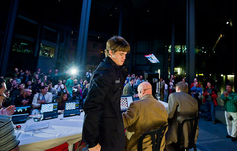 Carlsen leaving the stage after the press conference. Photo by Fred Lucas.