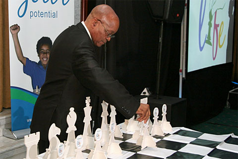 President Jacob Zuma makes ceremonial move to launch initiative. Photo by Supreme Chess Trust.