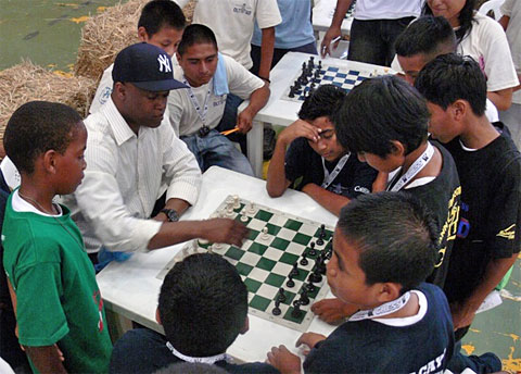 GM Maurice Ashley in a teachable moment with Belizean youth.