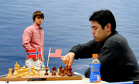 EPIC BATTLE! Nakamura on the move as Carlsen watches. Photo by Frits Agterdenbos of ChessVista.