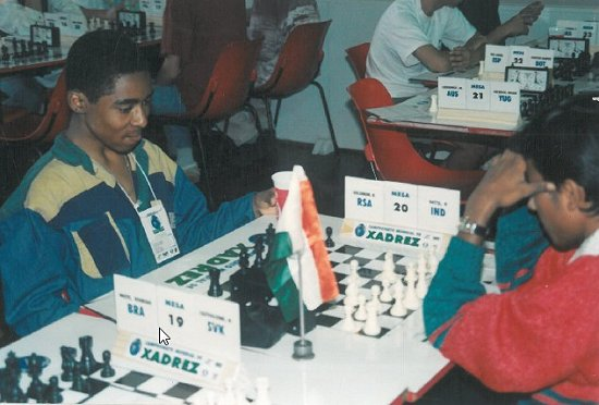 Happy for a game! Kenny playing Prasenjit Dutta of India at the World U16, Brazil.