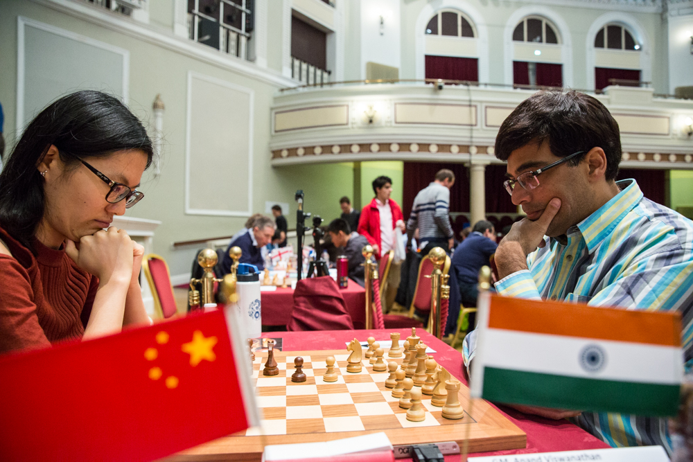 Hou Yifan and Vishy Anand in Round 9