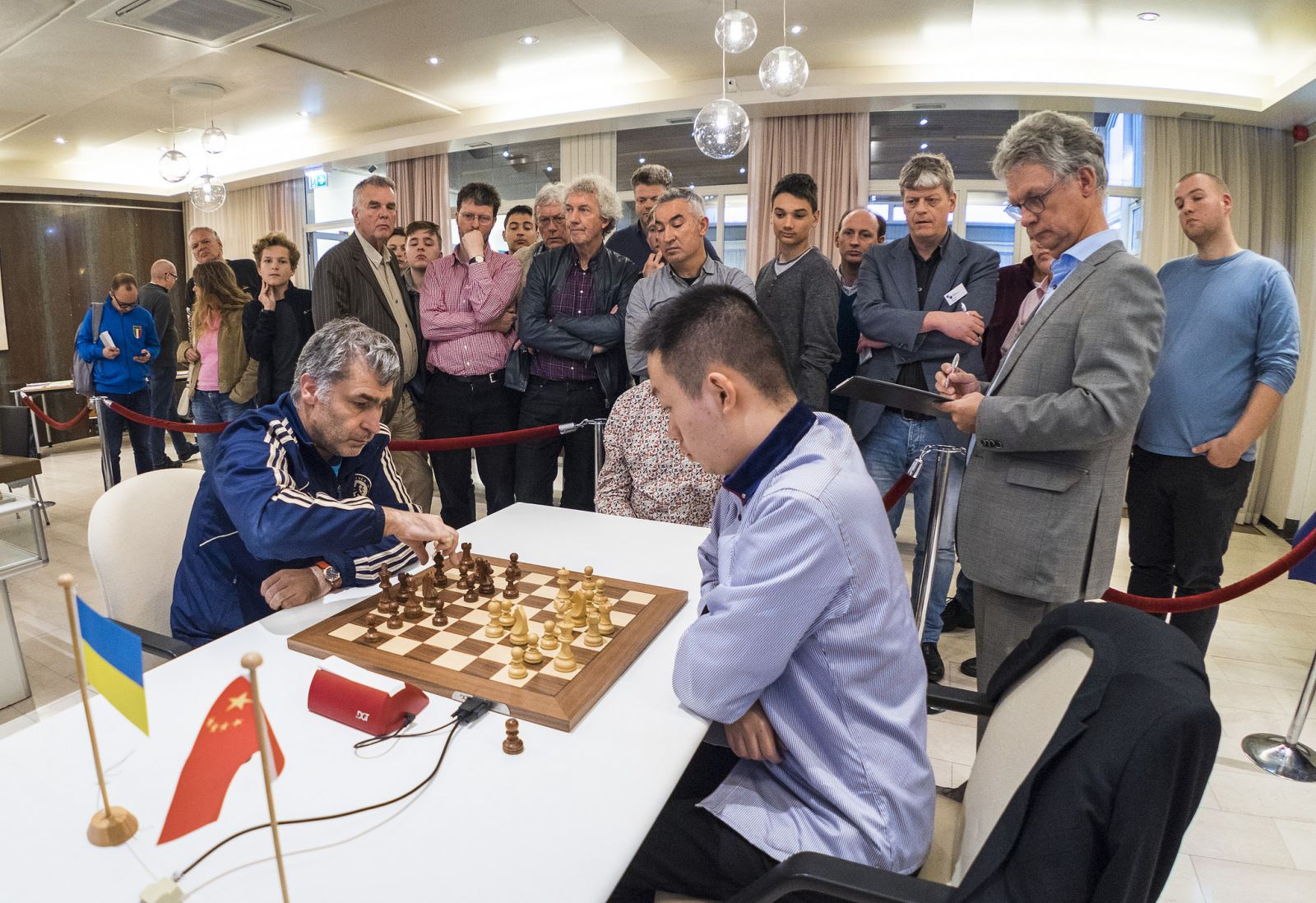 Vassily Ivanchuk and Wei Yi during the blitz playoff