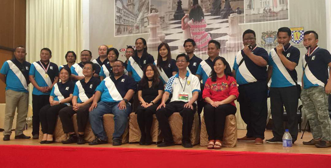 "Of notable mentions were the facts that the State of Sabah sent four teams for the competition, namely, the Kinabalu Kings, Kinabalu Queens, Kinabalu Knights and Kinabalu Pawns. Additionally, two of the teams were made up of players who are hard of hearing – this is a recent training initiative sponsored by Yayasan Rakyat 1Malaysia and supported by the Penang Chess Association that is aimed at extending the inclusive nature of chess to the deaf. Adding to that, the youngest player in the chess league team was 4-year and 6 months' old Malaysian, Ain Safiya binti Rosli of team AAAA. Ain Safiya became the youngest ever contestant in the entire chess festival!    After 8 gruelling rounds, the Filipino quartet of IM Emmanuel Senador, IM Nouri Hamed, Ian Udani and FM Alekhine Nouri of PCA Team emerged victorious to become Champion. ""PCA"" in the team name does not stand for Penang Chess Association. Instead, ""PCA"" would have likely stood for ""Philippine Chess Alliance"". IM Senador and IM Hamed also won board prizes. JUMP KING, led by Deni Sonjaya, finished runner-up, while The Big Lift finished Third."