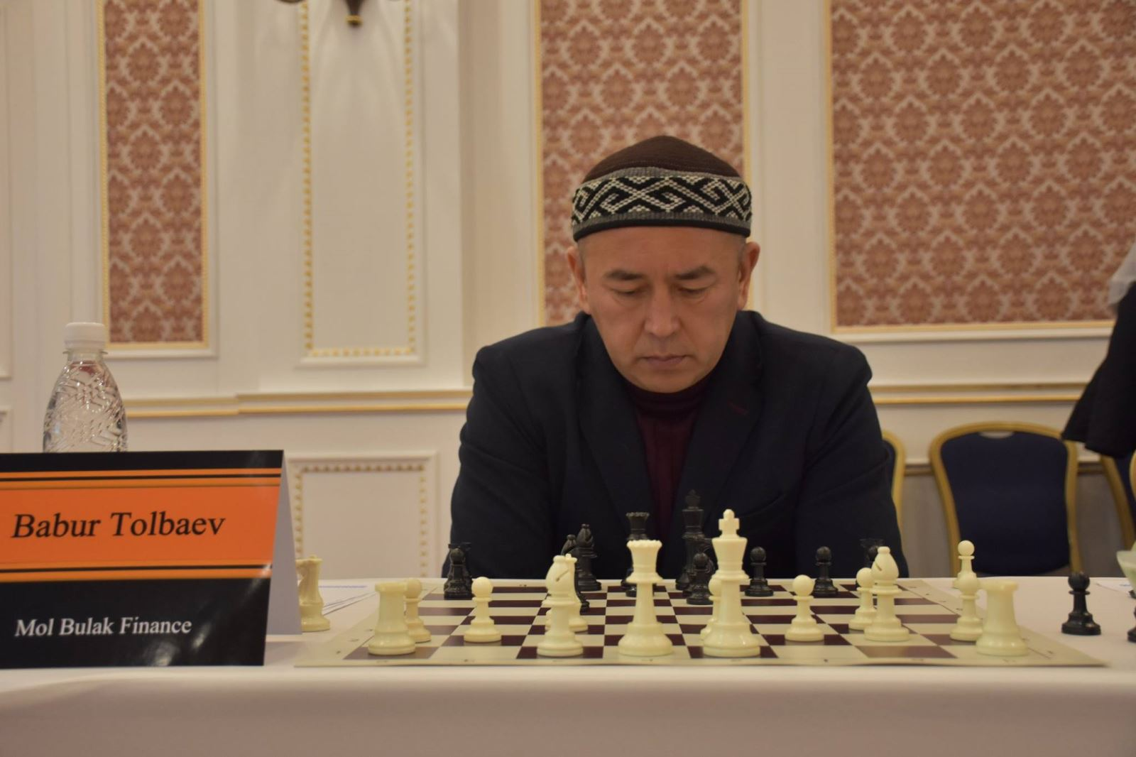 General Director of Mol Bulak Finance, Mr Babur Tolbaev playing against Nigel Short at the simultaneous exhibition