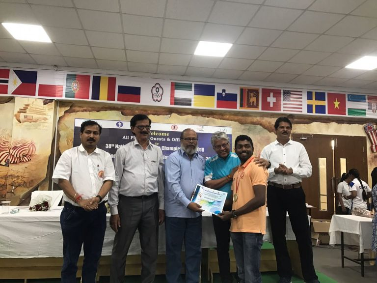 Adhiban receiving his board prize at the 38th Indian National Team Championship in Odisha, India