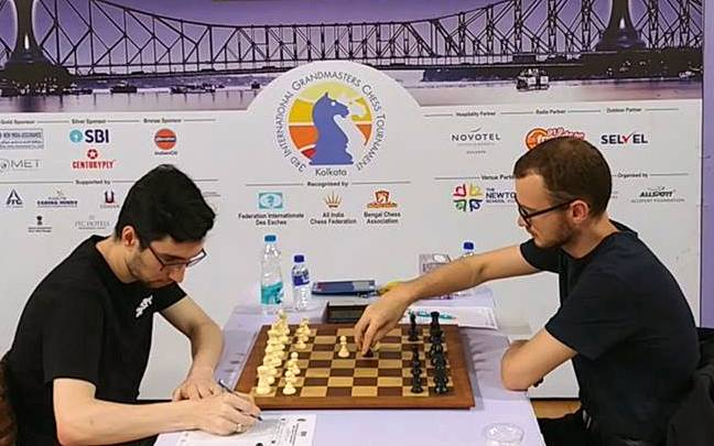 Round 6 game between Adam Tukhaev and Ivan Rozum at the Kolkata International GM Open