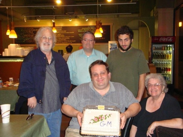 GM Finegold celebrating his GM title with his family, and father on the left.