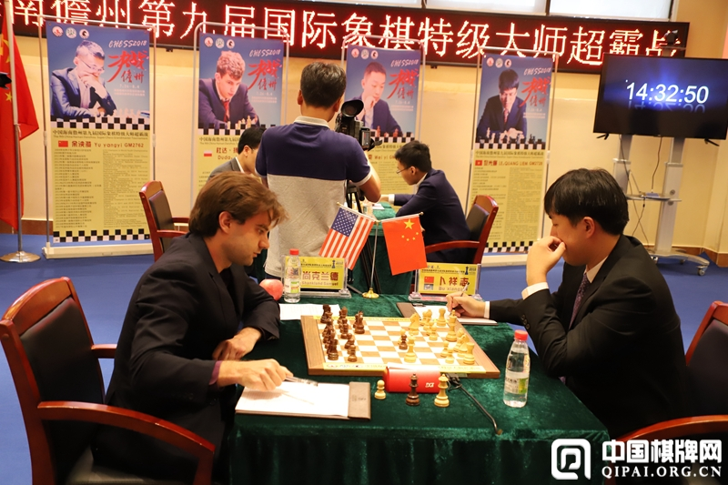 Bu Xiangzhi and Samuel Shankland during their first round game at the Danzhou Masters