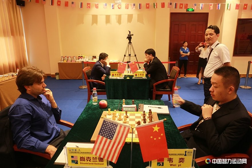 Wei Yi playing against Samuel Shankland in the second round of Danzhou Masters