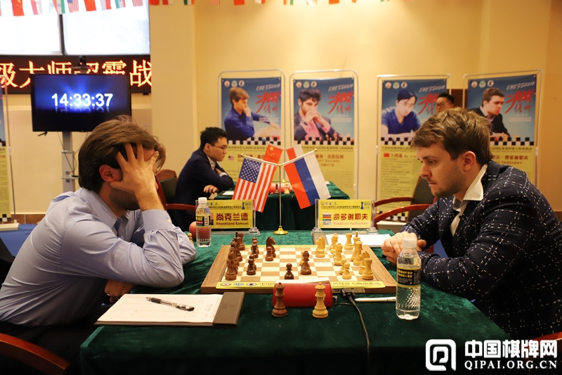 Vladimir Fedoseev and Sam Shankland during their fifth round game at the Danzhou Masters