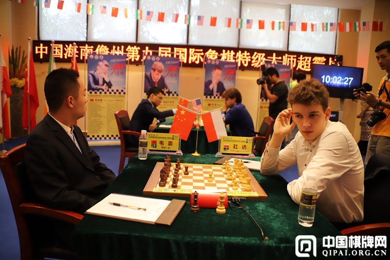 Jan Krzysztof Duda playing against Wei Yi in the final round of the Danzhou Masters
