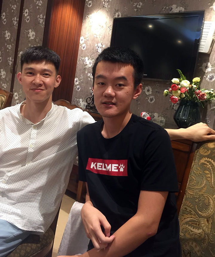 Ding at home with a friend