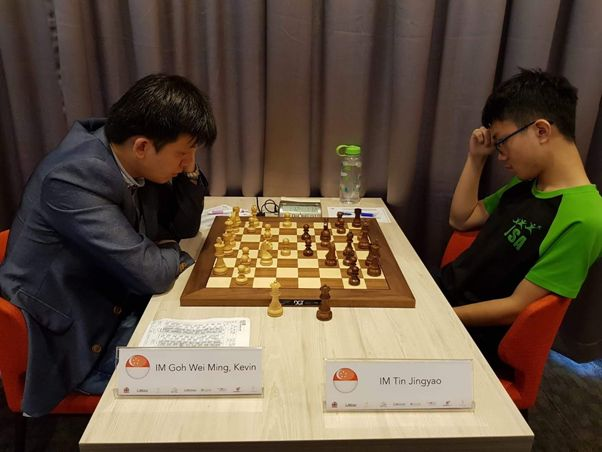 Kevin Goh playing against Tin Jingyao at the QCD-Prof Lim Kok Ann Grandmasters Invitational 2018