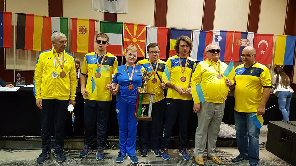 Ukraine taking the third place trophy at the IBCA World Team Championship