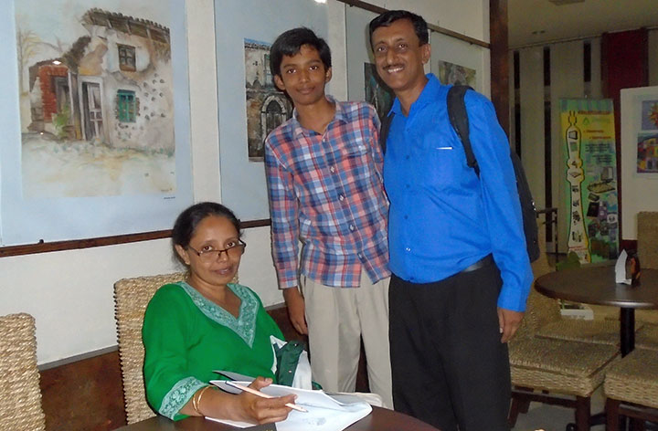 Alok Sinha and his parents