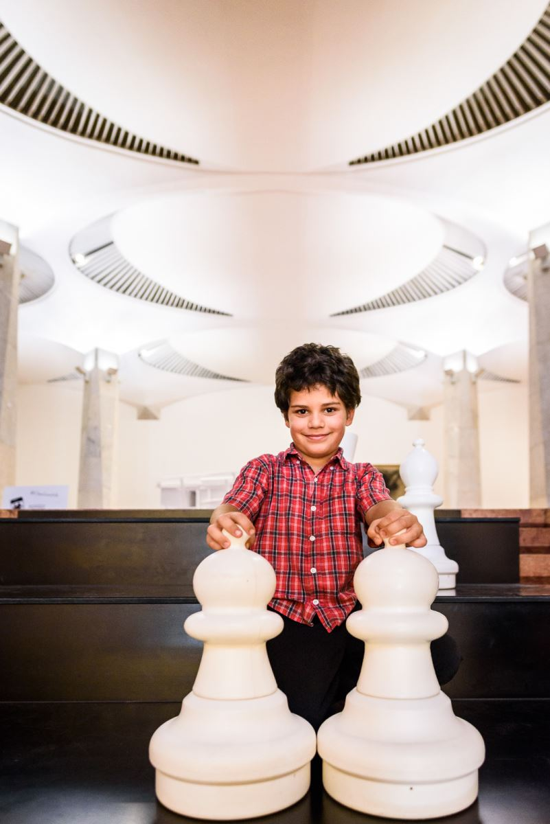 boy with large pawns