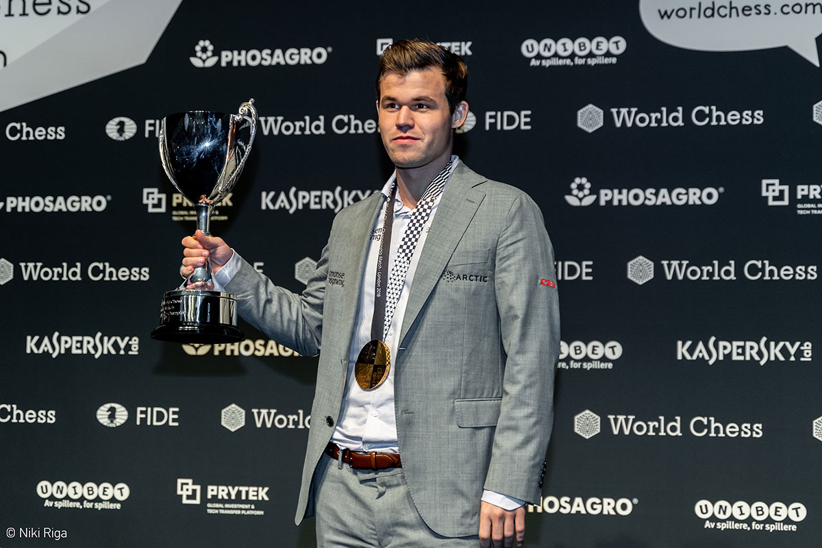 Carlsen with trophy