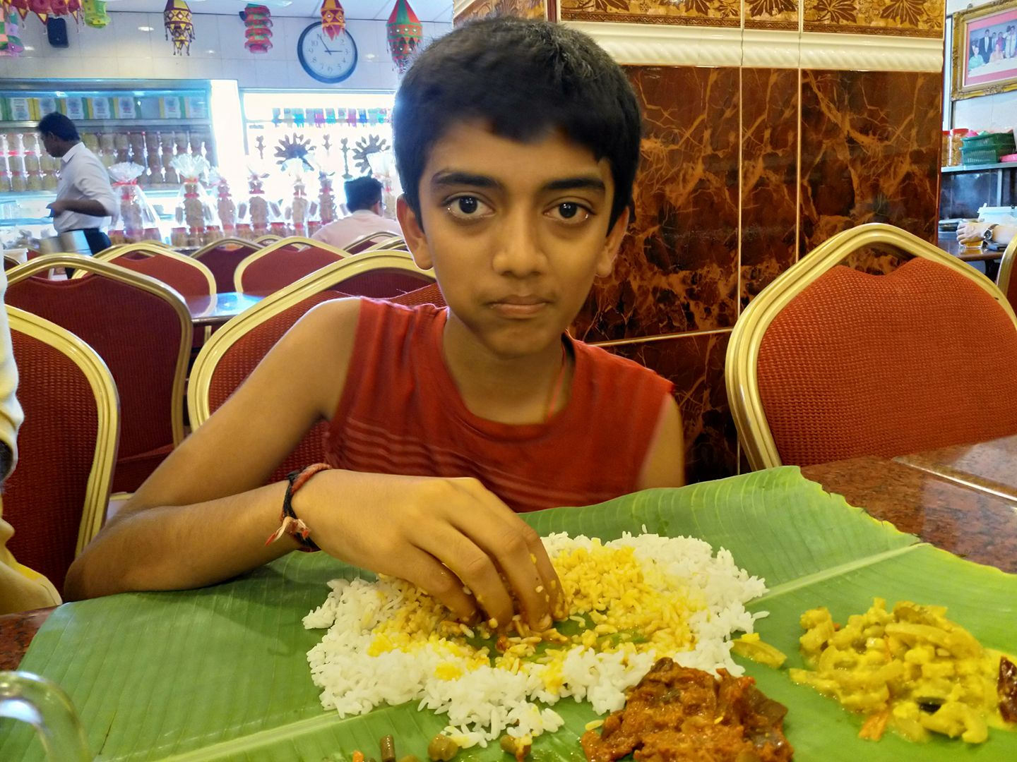 Gukesh eating rice
