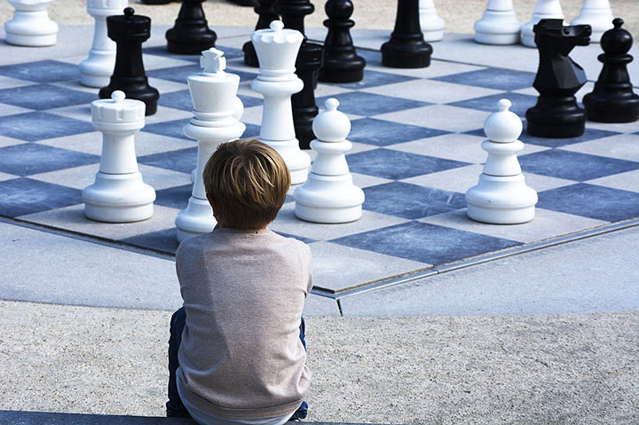 Boy at chess board
